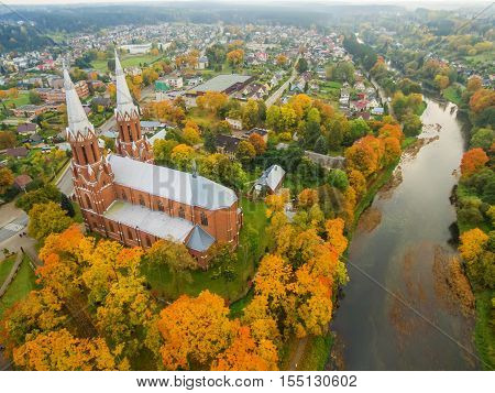 Anyksciai, Lithuania: aerial UAV top view of neo-gothic roman catholic church in the autumn
