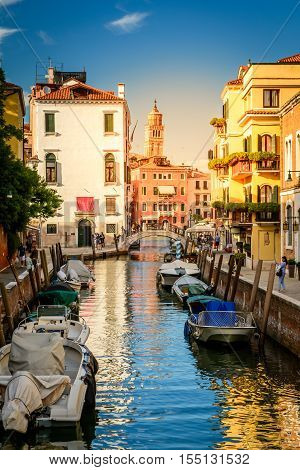 Venice Italy - August 13 2016: Venice Italy. Water canal in Venice with boats and gondolas