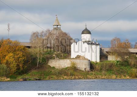 View of medieval church of Saint Georgy in the cloudy October afternoon. Old Ladoga fortress, Russia