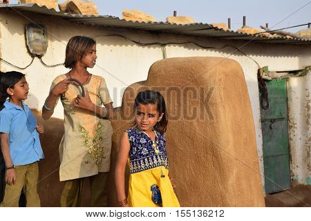 JAISALMER, RAJASTHAN, INDIA - FEBRUARY 12, 2016 - Unidentified indian kids in a village inside Thar desert
