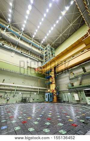 Reactor room RBMK. Massive reactor lid, equipment maintenance and replacement of the reactor fuel elements. Visible charge discharge machine