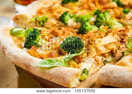 Closeup Of Fresh Pizza With Broccoli, Chicken And Cheese