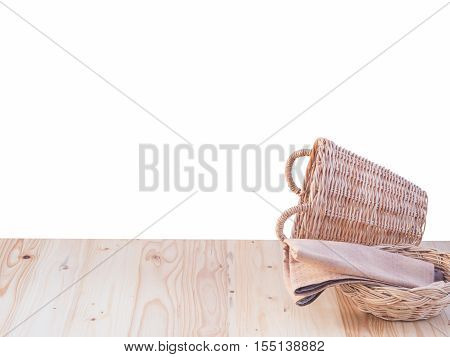 Wicker Basket And Fabric On Wooden Terrace Pine.  Isolated On White Background.