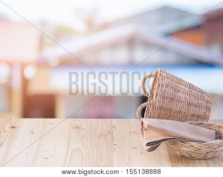 Wicker Basket And Fabric On Wooden Terrace Pine.