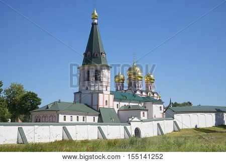 The old belfry and dome of the Cathedral of the Icon of Mother of God of Iver, sunny day. Svyatoozerskaya Iveron Theotokos the monastery