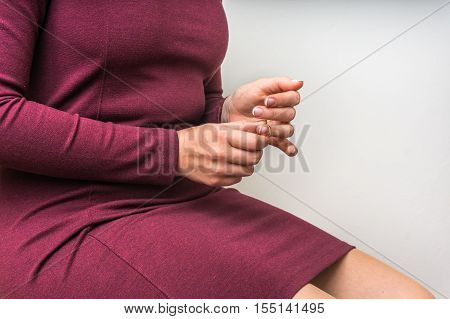 Woman Taking Off The Wedding Ring - Divorce Concept