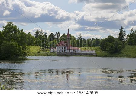 GATCHINA, RUSSIA - JULY 05, 2015: Priory Palace on the Black lake, cloudy july afternoon. The historical landmark of the city Gatchina