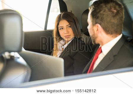 Businesspeople Working In A Car