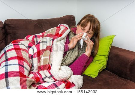 Sick Woman Having Flu And Blowing Her Runny Nose