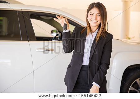 Young Woman Selling A Car At The Dealership