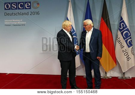 POTSDAM GERMANY. SEPTEMBER 1ST 2016: Federal Foreign Minister Dr Frank-Walter Steinmeier welcomes Boris Johnson Secretary of State for Foreign and Commonwealth Affairs of the United Kingdom of Great Britain and Northern Ireland to the Informal OSCE Foreig