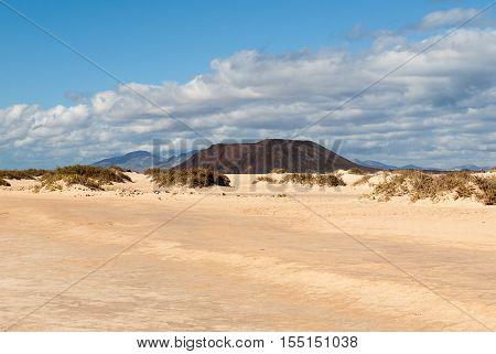 Corralejo sand dunes and extinct volcanoes in the background. Fuerteventura Canary Islands Spain