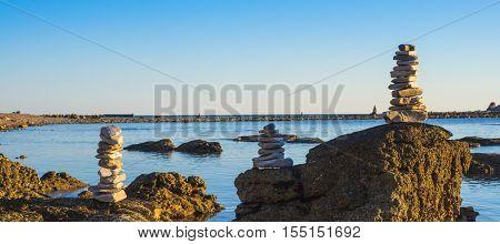 Stone beach in Zabratija at the sunset Umag Croatia
