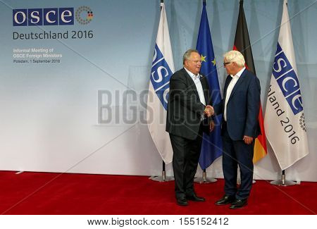 POTSDAM GERMANY. SEPTEMBER 1ST 2016: Federal Foreign Minister Dr Frank-Walter Steinmeier welcomes Nikos Kotsiaz Minister of Foreign Affairs of Hellenic Republic to the Informal OSCE Foreign Minister's Meeting held in Potsdam Germany