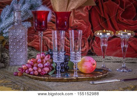 A luxury dinner table in christmas decorations with glasses and fruit