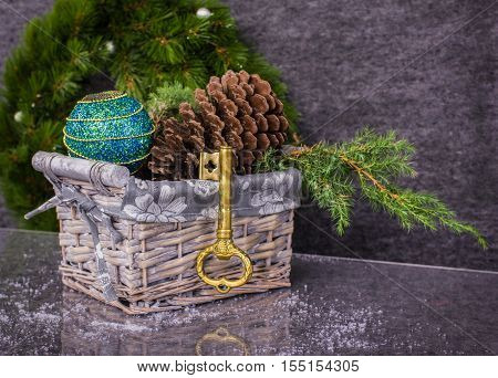 Christmas gift. Christmas decoration in basket with gold colored key
