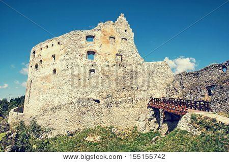 Ruins of Topolcany castle Slovak republic central Europe. Ancient architecture. Beautiful place. Retro photo filter. Travel destination.