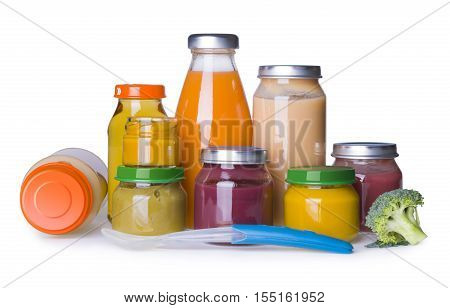 Baby food jars and juice bottles isolated on white