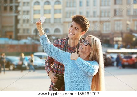 Young couple taking selfie, outdoors
