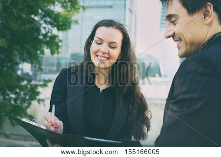 Two Business People Sign An Agreement