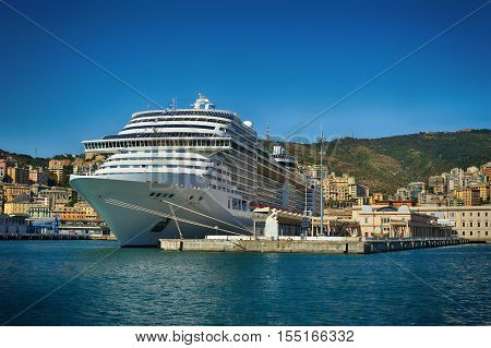 Huge sea cruise ferry in the Genova port, transport vacation background