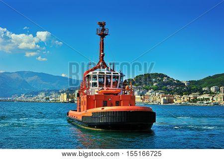 Red Fire boat in port Genova, Pegli , Italy