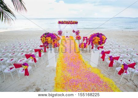 Floral Arrangement At A Wedding Ceremony On Beach..