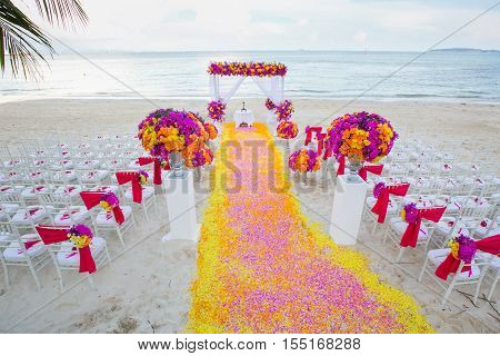 Floral Arrangement At A Wedding Ceremony On Beach..