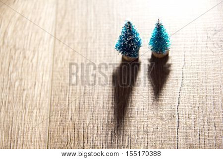 two Christmas trees on the background of bright Christmas gifts, bright colored lights, place under the text as substrate