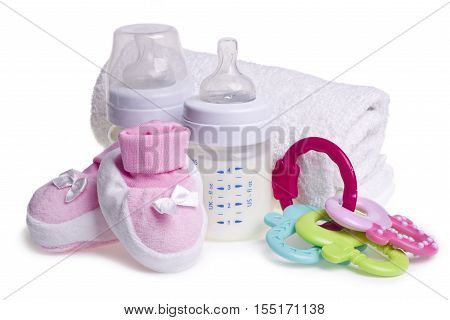 Composition of baby booties bottles and toy for teething