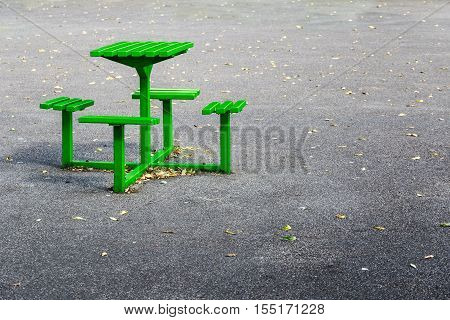 Green metal bench table set in a playground
