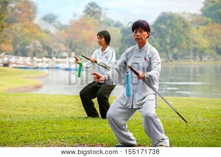 Bangkok, Thailand - February 20, 2016: Unidentified Group Of People Practice Chinese Sword With Tai