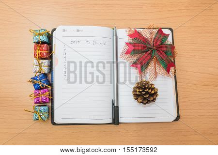 Notebook On A Wooden Table With 2017 To Do List Concept
