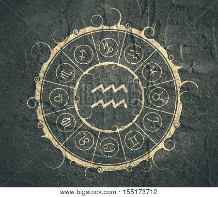 Astrological symbols in the circle. Concrete wall textured. Water bearer sign