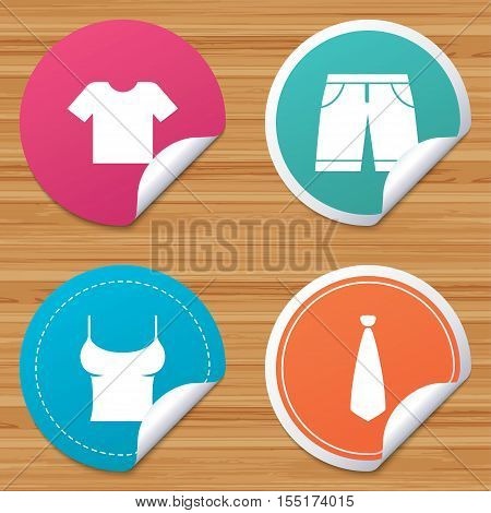 Round stickers or website banners. Clothes icons. T-shirt and bermuda shorts signs. Business tie symbol. Circle badges with bended corner. Vector