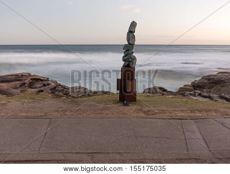 5th of November 2016 Bondi Beach Sydney Australia. Sculpture titled Stack by Clara Hali with the motion-blurred sea in the background at Sculpture by the Sea at sunset