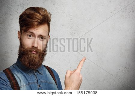 Body Language. Isolated Shot Of Surprised And Amazed Hipster Young Man With Fuzzy Beard Wearing Susp