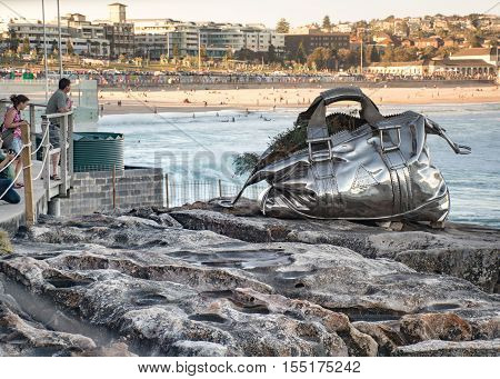 5th of November 2016 Bondi Beach Sydney Australia. People admiring the sculpture Travelling Bag by Yumin Jing during the Sculpture by the Sea yearly free outdoor exposition