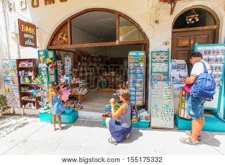 Rethymnon Island Crete Greece - July 1 2016: Family near the souvenir store
