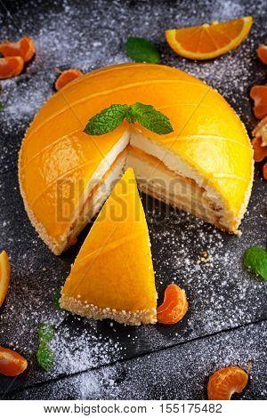 Cake witch Orange mousse, Mandarin saucea and fruit. poster