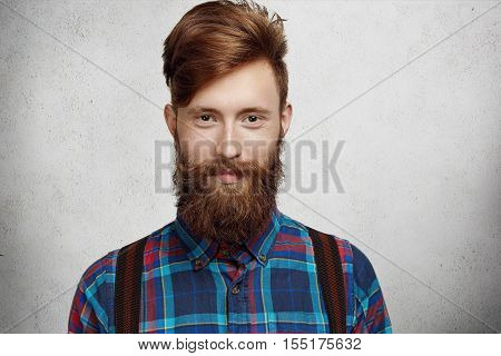 Portrait Of Handsome Student With Trendy Beard And Mustache Dressed In Fashionable Checkered Shirt L