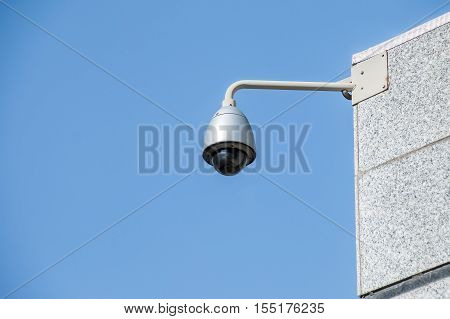 Modern Security Camera Over Blue Sky Background