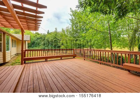 Exterior Of Horse Ranch With Large Wooden Walkout Deck