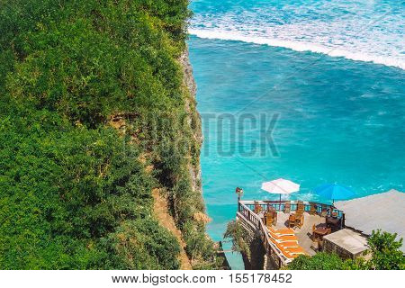 Blue Point beach coastline with beautiful rocky cliffs and turquoise wavy sea of Uluwatu region in Bali island, Indonesia. Asia nature landscape