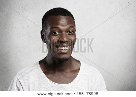 Positive Human Face Expressions, Emotions And Feelings. Close Up Portrait Of Good-looking African Yo