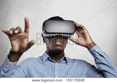 3D Technology, Virtual Reality And Entertainment Concept. African Businessman Playing Simulation Gam