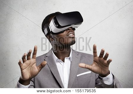 Gaming, 3D Technology And Cyberspace. Dark-skinned Entrepreneur In Formal Suit Experiencing Virtual