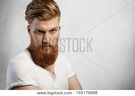 Human Face Expressions And Emotions. Headshot Of Young Model With Thick Beard Posing In Studio With