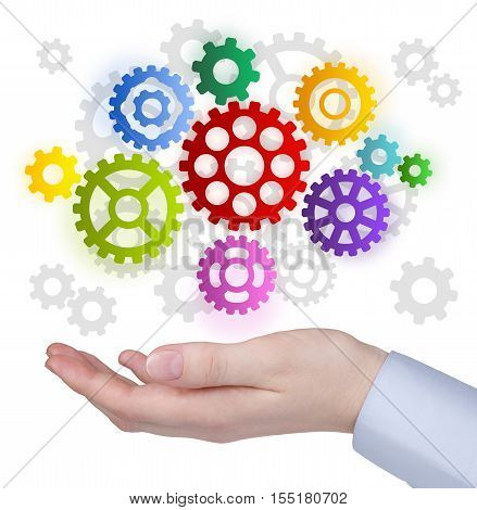 Hand with colorful cog weels on white background