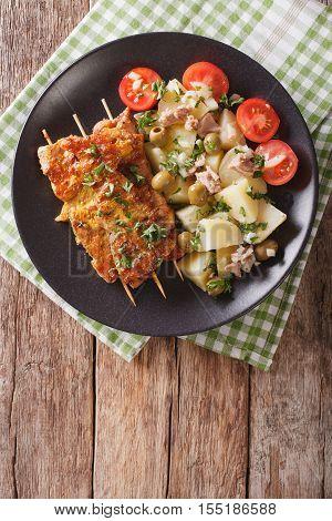 Spanish Pork Kabobs - Pinchos Morunos And Potatoes Salad Closeup. Vertical Top View